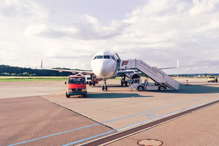 Airplane getting ready for take with cruise line extension booking